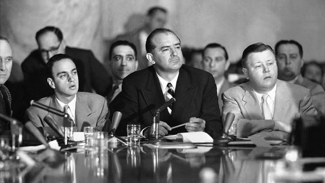 Senator Joseph McCarthy (R-Wis), juts out his jaw as he listens to testimony April 22, 1954 by Maj. Gen. Miles Reber. Reber said McCarthy and his aide, Roy Cohn, pressed him for an officer's commission for G. David Schine, committee consultant eventually drafted into the Army as a private.