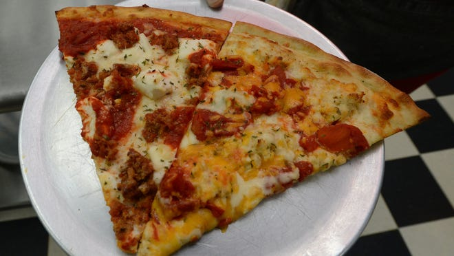 Two of the specialty pizzas at Paul's are the lasagna, left, and crab pizza.