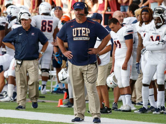 UTEP head coach Sean Kugler can only look on from the