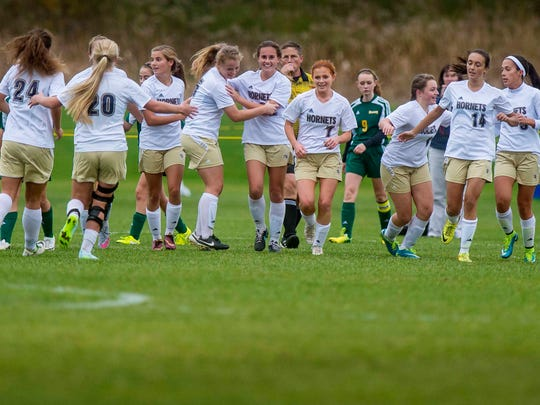 The Essex girls soccer team celebrates a goal against BFA-St. Albans during a 2015 playoff game in Essex.