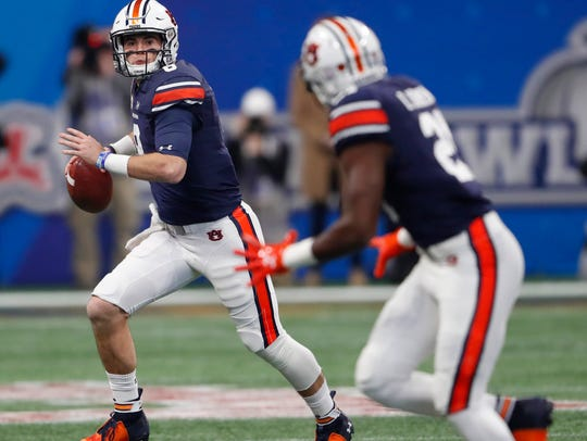 Auburn quarterback Jarrett Stidham (8) looks for a