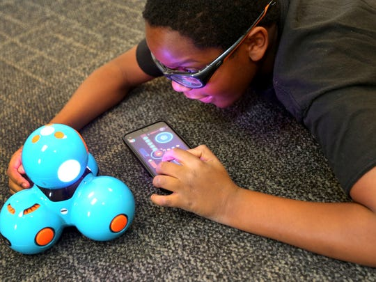 Austin Bilbro, 9, works on a dash and dot coded robot, during STEAM Week of Camp STEM at MTSU on July 18, 2016. In addition to science, math, engineering and technology, this camp includes performing arts and how the science and arts can be combined.