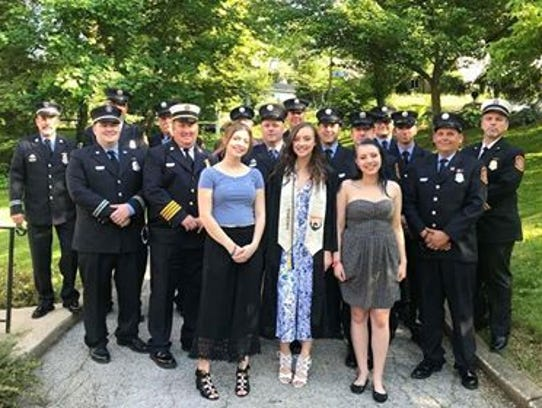 Members of the York City Fire Department's 'B' platoon pose with fallen firefighter Ivan Flanscha's daughters -- from left, Selena, Savannah and Sierra -- before Savannah's graduation from York Suburban High School on Thursday, May 24, 2018.