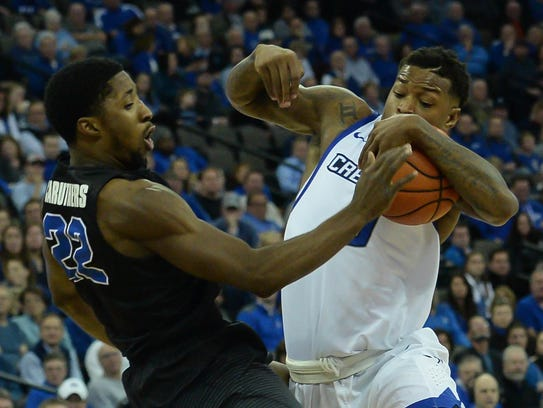 East High graduate Dontay Caruthers, left, was named the Mid-American Conference Defensive Player of the Year last season.