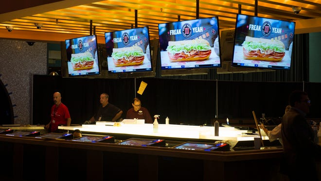 Employees work in the sports betting area inside the new Ocean Resort Casino Wednesday, June 27, 2018 in Atlantic City, N.J.