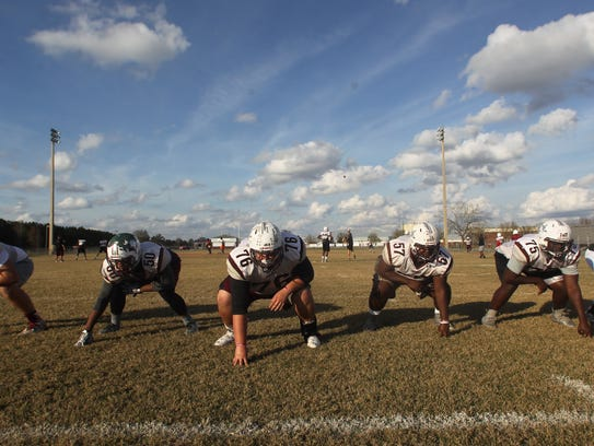 Madison County's offensive line has been paving the way for big games running the ball as the Cowboys have reached the FHSAA Class 1A state championship. From left: right tackle Zane Herring, right guard Ta'Ronn Johnson, center Zac Coe, left guard Quonmane Washington, left tackle Ahmad Powell, tight end Darius Johnson.