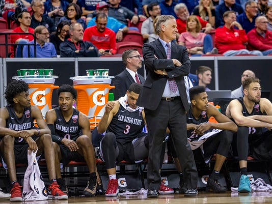 San Diego State head coach Brian Dutcher smiles during the second half of an NCAA college basketball game against Nevada in the semifinals of the Mountain West Conference tournament Friday, March 9, 2018, in Las Vegas.  (AP Photo/L.E. Baskow)