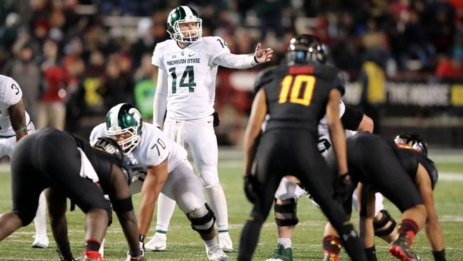Michigan State Spartans quarterback Brian Lewerke (14) led the offense against the Maryland Terrapins at Byrd Stadium.
