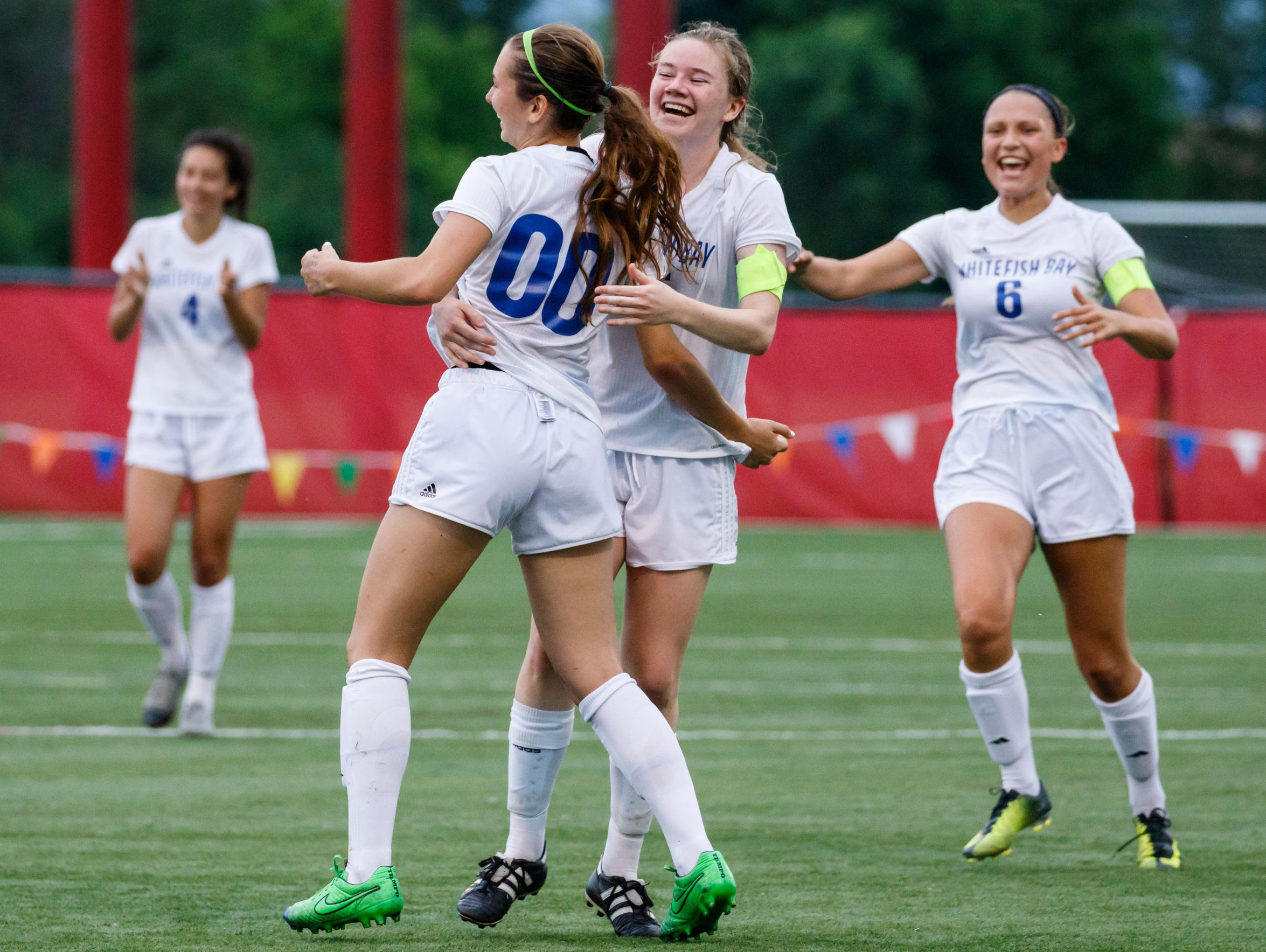 Whitefish Bay players rush to congratulate Taylor Kerwin