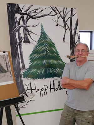 "Colin Peck painted ""Lone Christmas Tree,"" which was   Jessica Baker's winning entry in the high school division."