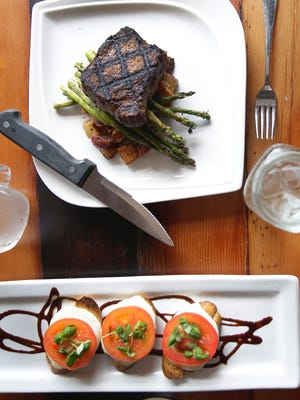 The Cannery Public Market is preparing several dishes to add to its menu for Green Bay Restaurant Week. A 6-ounce Manhattan cut New York Strip steak, top, with roasted baby red potatoes and grilled asparagus and traditional bruschetta with balsamic reduction and micro basil.
