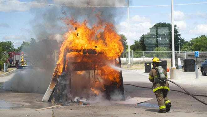 A simulated garage fire, caused by fireworks, is extinguished as Detroit's fire department gave a demonstration on fireworks safety at Engine 27, in Detroit on Tuesday.