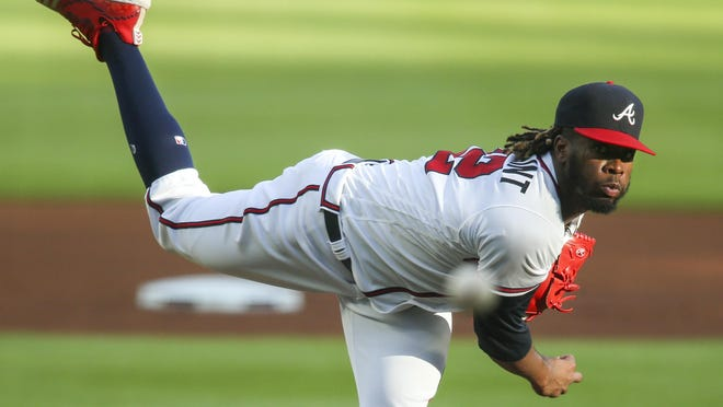Atlanta Braves starting pitcher Touki Toussaint throws against the New York Mets in the first inning at Truist Park.