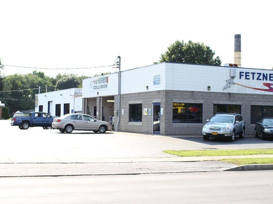 A view of Fetzner Collision, which is located on Dewey Avenue.
