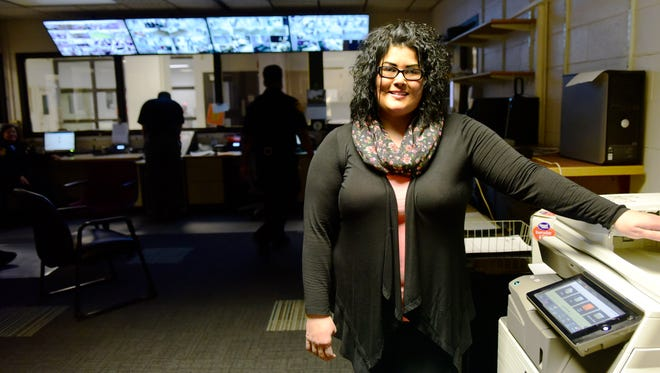 Emily Longoria balances her role as a single mother with her job as a corrections officer with the Sandusky County Sheriff's Office.
