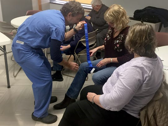 Dr. Shawn Terry, WellSpan trauma surgeon, demonstrated how to apply a tourniquet to a leg wound at the WellSpan event.
