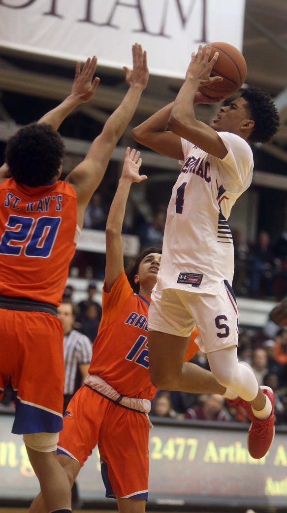 Stepinac's RJ Davis shoots over Luis Kortright and