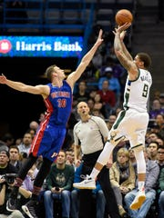 Bucks forward Michael Beasley (9) takes a shot against Pistons forward Jon Leuer (30) in the third quarter of the Pistons' 102-89 loss Monday in Milwaukee.