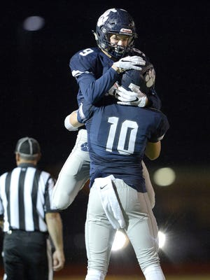 Pittsford's Jacob Robinson, top, and Jared Petrichick celebrate their comeback win over McQuaid during a Section V Class AA semifinal played at SUNY Brockport, Saturday, Oct. 28, 2017. No. 1 seed Pittsford advanced to the Class AA final with 35-27 win over No. 5 seed McQuaid.