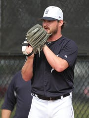 Tigers pitcher Travis Wood throws a bullpen session Feb. 14.