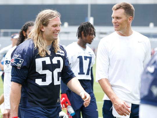 Jun 5, 2019; Foxborough, MA, USA; New England Patriots quarterback Tom Brady (12) shares a laugh with New England Patriots defensive end Chase Winovich (52) as they walk off the field during mandatory minicamp at the Gillette Stadium practice field. Mandatory Credit: Greg M. Cooper-USA TODAY Sports