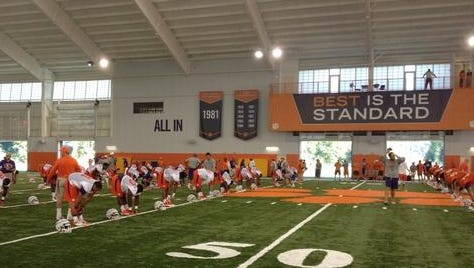 The Tigers stretch before practice.
