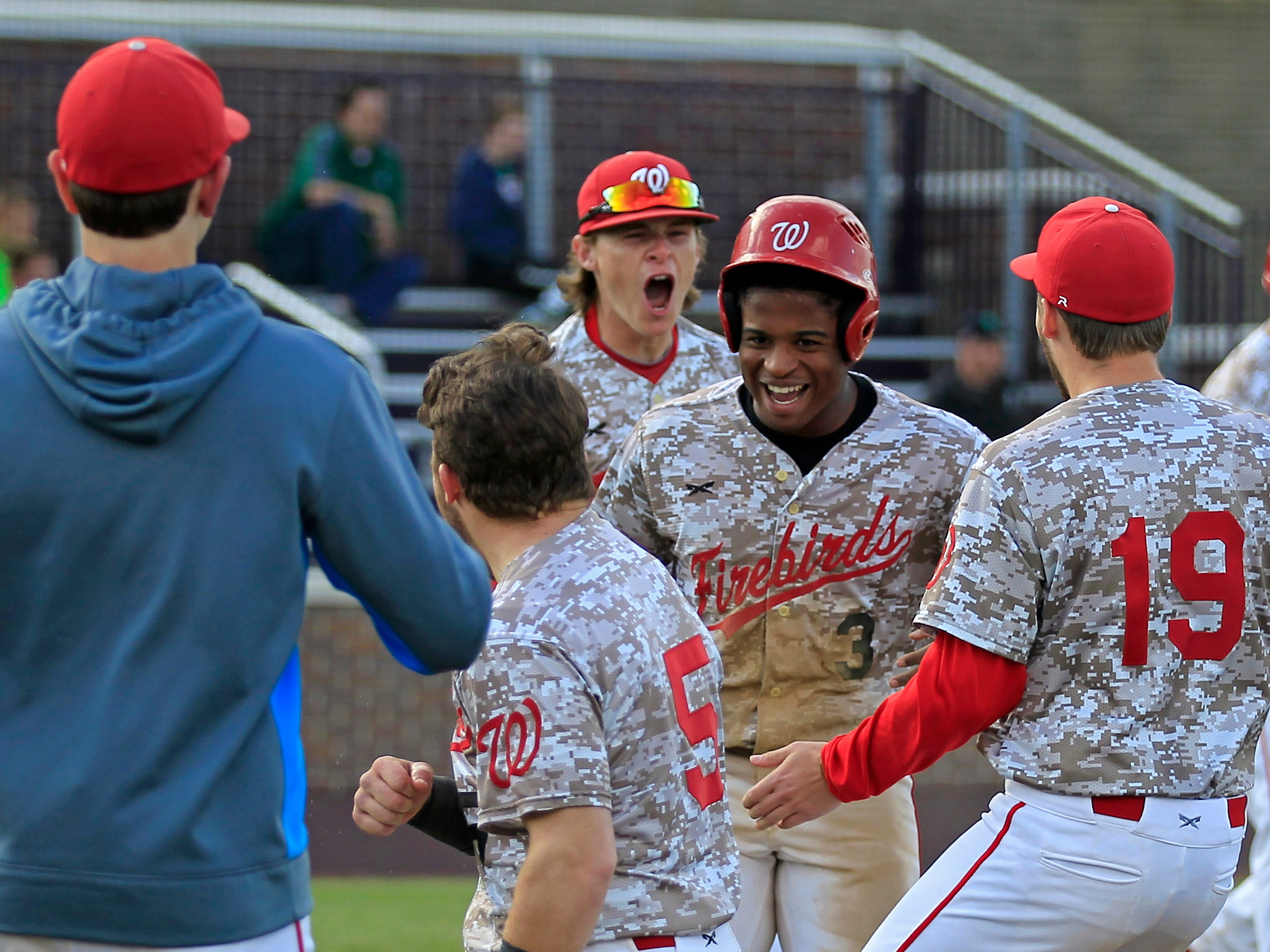 052115 LAKOTAHARRISON Thursday, May 21, 2015. CINCINNATI The Lakota West bench celebrates after senior Jeremiah Johnson's RBI double scoring the fourth run during the bottom of the sixth inning of the OHSAA D1 sectional final game between Lakota West High School and Harrison High School at the Panther Athletic Complex in the Price Hill neighborhood of Cincinnati, on Thursday, May 21, 2015. Lakota West defeated Harrison, 4-0, to advance to the District Final. (The Enquirer/Sam Greene)