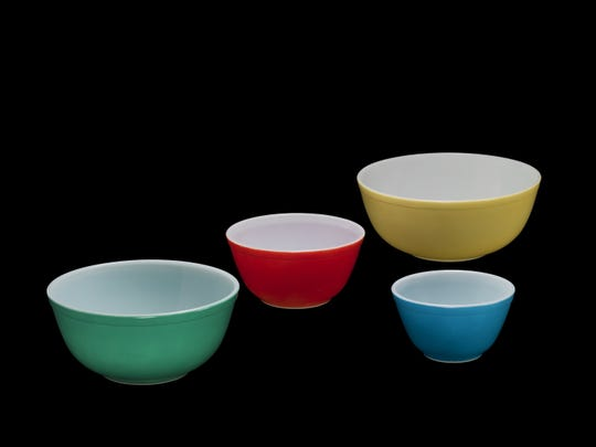 A set of multicolored Pyrex mixing bowls that were introduced in the 1940s is part of the exhibition at the Corning Museum of Glass, marking the centennial of Pyrex cookware.