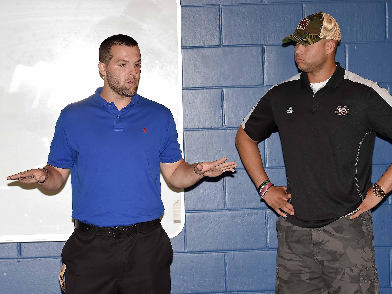 Clayton Moore (left) and Tyler Russell, quarterbacks in the 2008 Dandy Dozen, speak to the 2015 Dandy Dozen at Mississippi Veterans Memorial Stadium in Jackson on Tuesday, July 28, 2015.