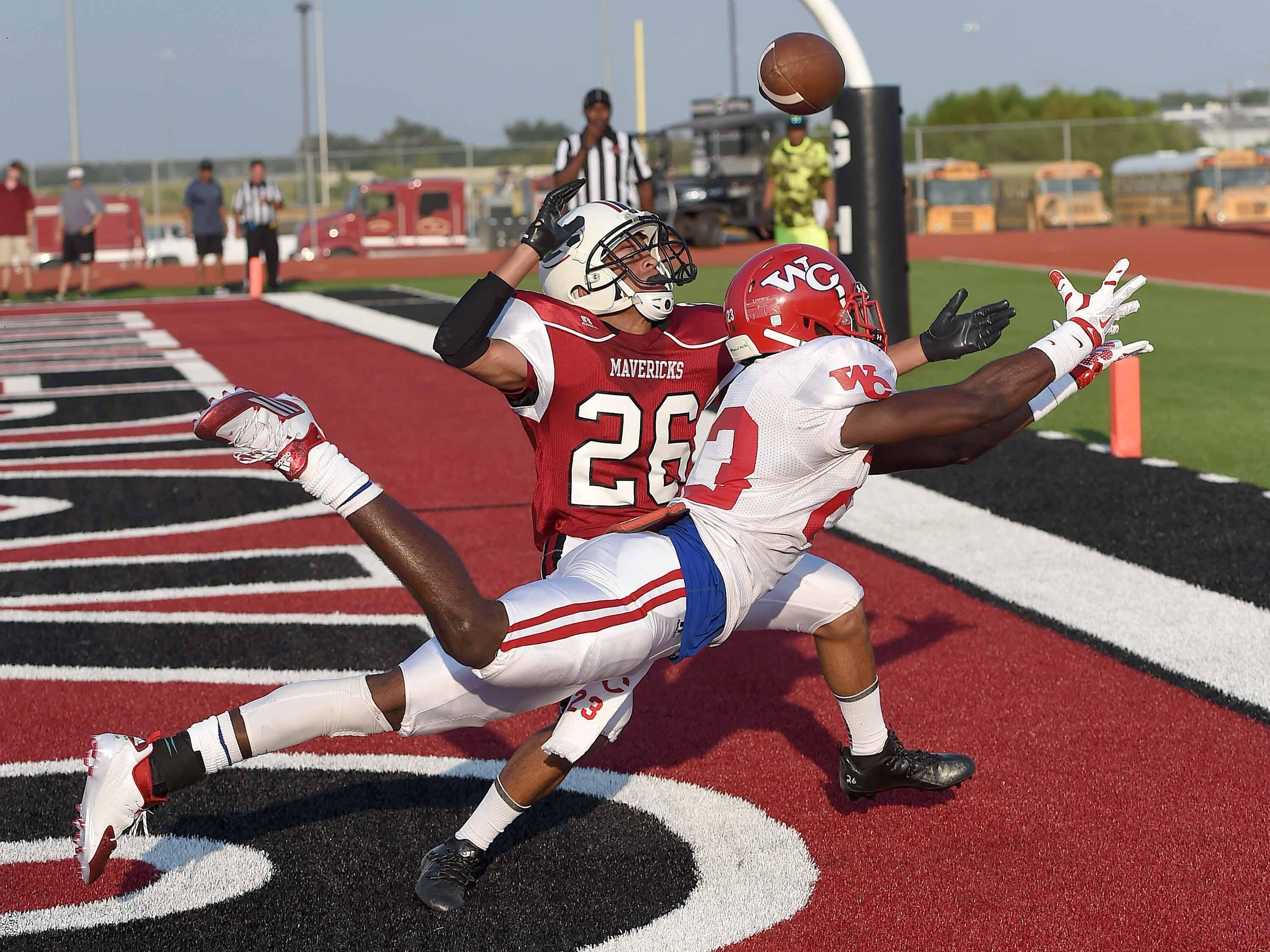 Warren Central receiver Derrick Dixon dives for a pass in the end zone against Germantown's Noah Greenwood on Friday.