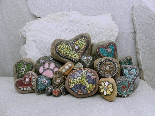 """A selection of mosaic stones handcrafted by Chris Emmert of Eugene. Emmert has been creating mosaic rocks since 2006. """"I still enjoy doing it because I like the rocks. There's never a bad rock out there,"""" she said."""