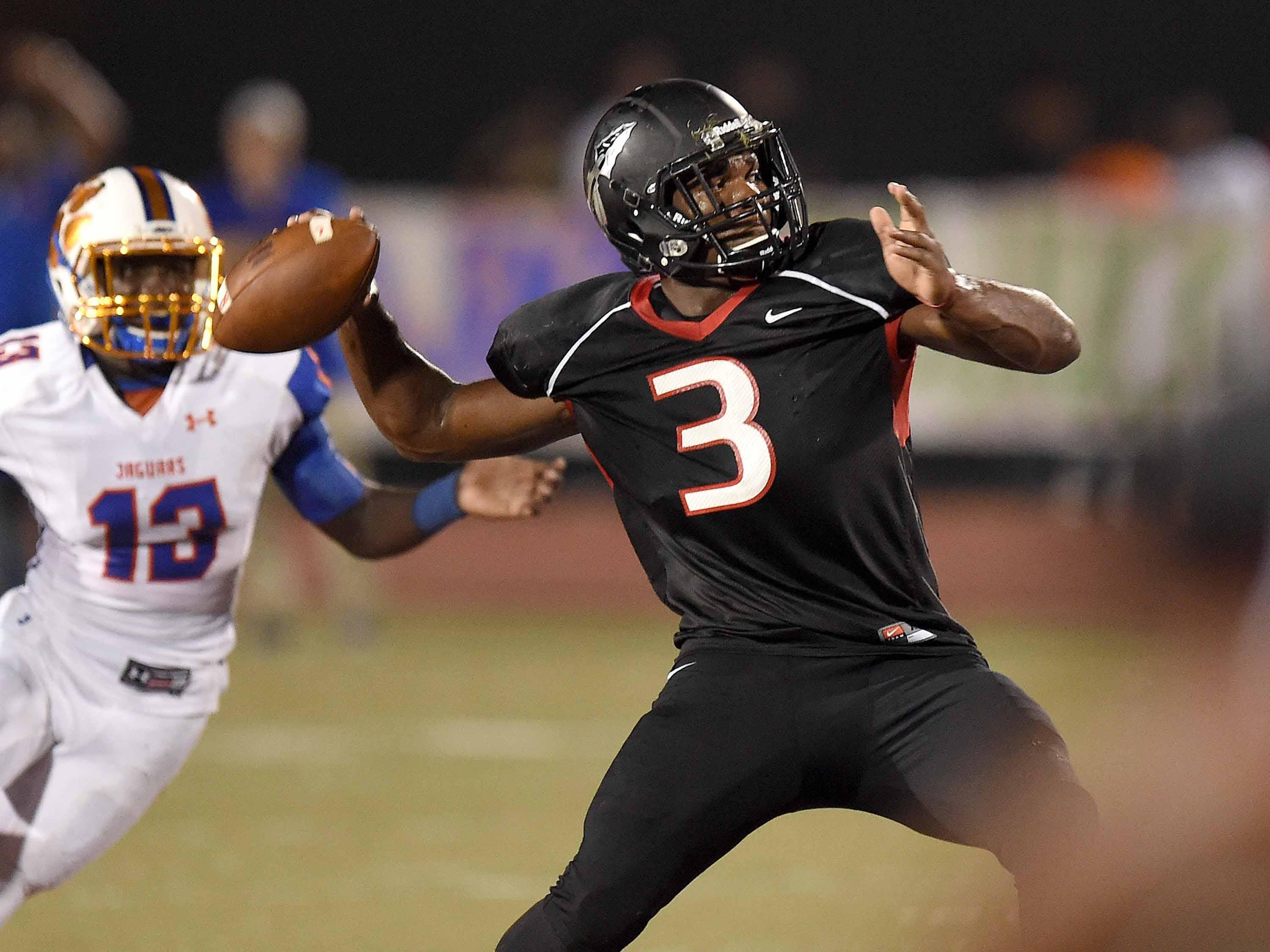 Clinton quarterback Cam Akers (3) rears back to throw a deep sideline pass to Darius Maberry for a touchdown against Madison Central on Friday, September 25, 2015, at Clinton High School in Clinton, Mississippi.