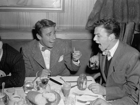 "Singer Frank Sinatra exclaims, ""Those peppers are hot!"" when actor Peter Lawford hands him another one as they dined at The Players in Hollywood, Ca., January 8, 1945. (AP Photo)"