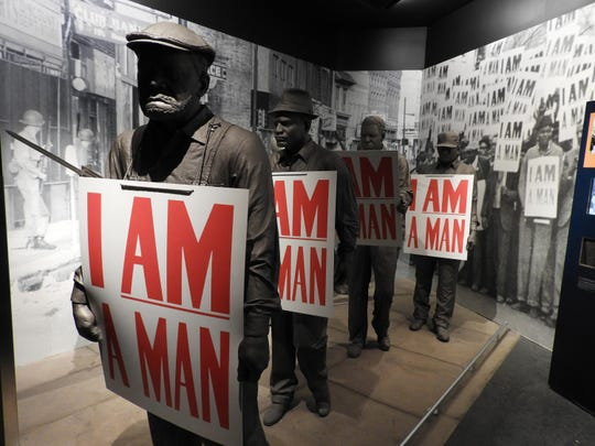 "In a museum exhibit detailing the 1968 strike by Memphis garbagemen, models of the sanitation workers hold placards that read ""I Am a Man,"" the battle cry of their successful effort to organize a union."