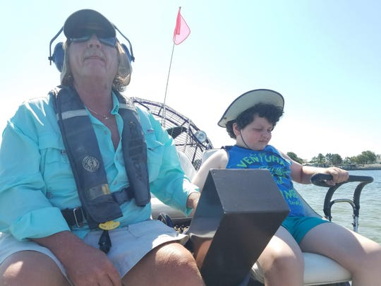 Samanda Feuss taking a turn driving the airboat with