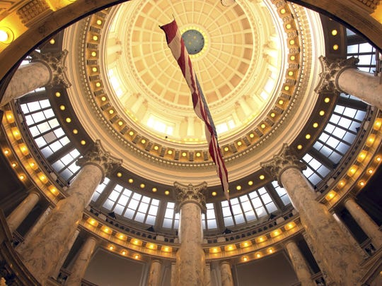 In this Feb. 26, 2018, file photo, an American flag hangs inside the rotunda of the Idaho Capitol in Boise, Idaho.