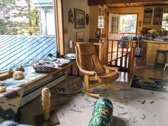 This May 4, 2019, photo shows extensive damage in the living room area of Stacy Studebaker's home in Kodiak, Alaska, after an eagle flew through a large window.