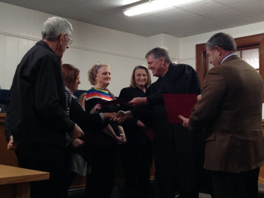 Judge Billy Bennett (second from right) of the 12th Judicial District Court, hands a certificate to Rita Saucier after she and five others were sworn in as CASA volunteers for Avoyelles Parish on Wednesday.
