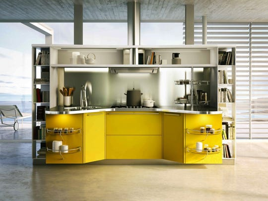 Snaidero's Skyline 2.0 kitchen system by Lucci & Orlandini, shown here in yellow high gloss lacquer, features customizable cabinets with stainless steel countertops.