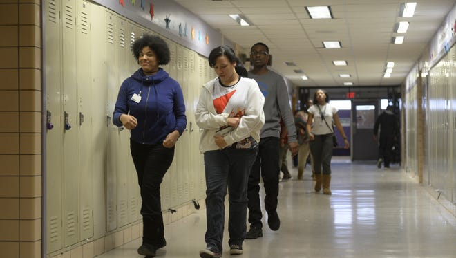 Communications and Media Arts School students head toward their next class at the Detroit school. A narrow majority of Michigan voters supports creating a commission in Detroit with the power to control how many charter schools can operate in the city, a new statewide poll shows.