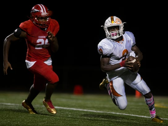 Dunbar's Seneca Milledge carries the ball during a tightly contested district matchup that came down to the final minutes as Immokalee defeated Dunbar 30-23 on Oct. 17.