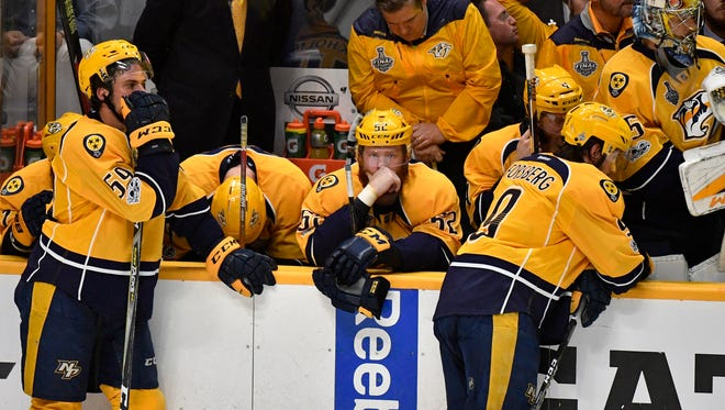 The Predators sit dejectedly on the bench in the closing seconds of game 6 of the Stanley Cup Final at Bridgestone Arena Sunday, June 11, 2017, in Nashville, Tenn.