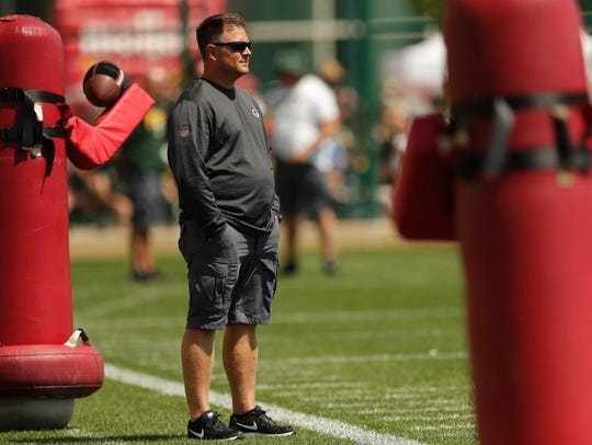 Brian Gutekunst watches a Packers practice.