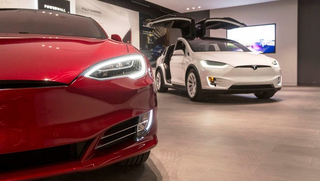 The Tesla Model S, left, and the Model X are seen in the showroom at Somerset Collection North in Troy on Thursday, October 26, 2017.