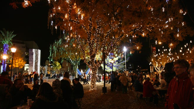 Event goers enjoy music and food at Glendale Glitters in downtown Glendale on December 20, 2013.