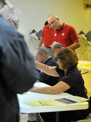 An election observer watches the voting process in Fairfield County in 2012.
