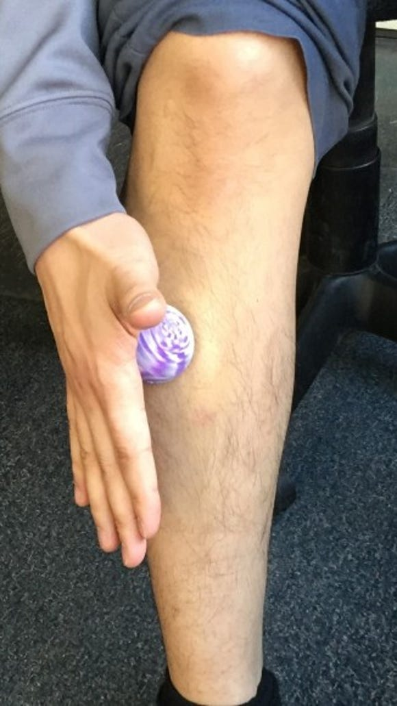 Self soft tissue work to tibialis anterior (yes that's my daughter's bouncy ball)