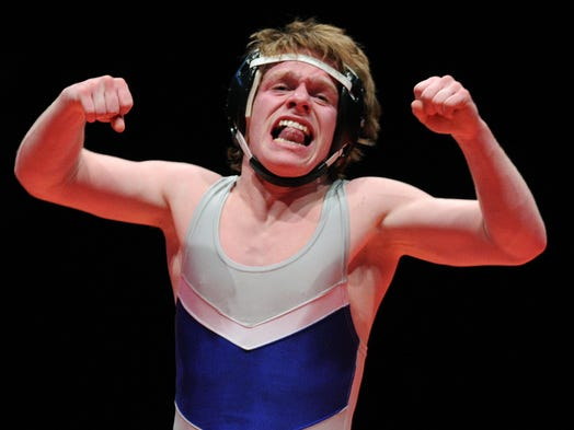 Franklin Community wrestler DJ Smith celebrates his victory over East Nobleâ??s Garrett Pepple in the 106-pound championship during the 76th annual IHSAA Wrestling State Finals inside Bankers Life Fieldhouse, Saturday, February 22, 2014, in Indianapolis.
