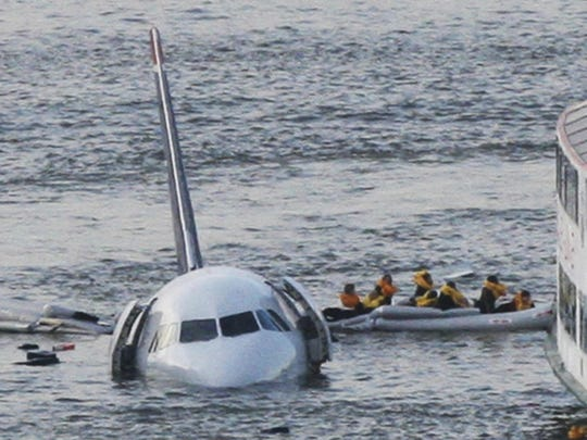 Passengers in an inflatable raft move away from an Airbus 320 US Airways aircraft that went down in the Hudson River in New York on Jan. 15, 2009.