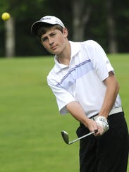 Albany's Dave Schneider practices his short game at